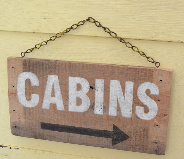 Cabins hanging sign stenciled on the side of an old crate