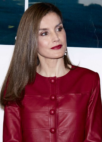 Queen Letizia wore Uterque red Leather jacket and Uterque beige pumps, Queen carried Uterque clutch bag, wore Hugo Boss skirt