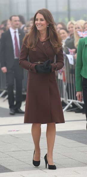 Kate Middleton wrapped up her baby bump in a brown Hobbs coat today when she arrived at the National Fishing Heritage Center