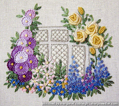 Elizabethan Window (by Roseworks): Completed embroidered window surrounded by flowers
