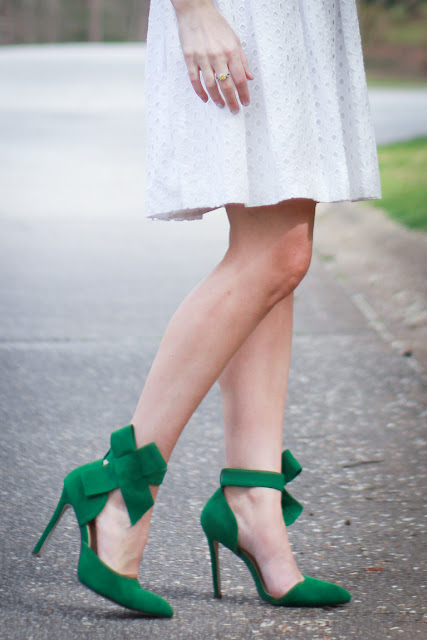 Fun St. Patrick's Day Outfit with white eyelet dress, statement bird earrings and green bow heels.  And good friends are lucky.