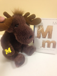 Stuffed animal teaching letter M