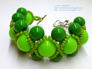 Bracelet of large round beads in green colors