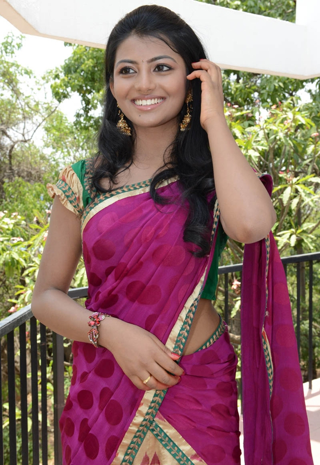 South Indian Actress Anandhi Smiling Face Hot Hip Navel Stills In Red Half Saree