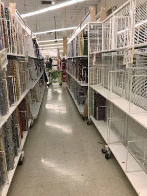 another half empty fabric aisle in JoAnn fabrics