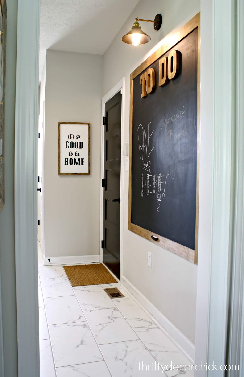 Mud room with huge chalkboard
