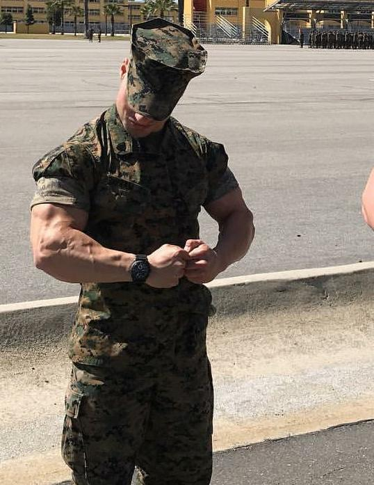 handsome-male-soldier-in-military-uniform-flexing-huge-veiny-muscle-biceps