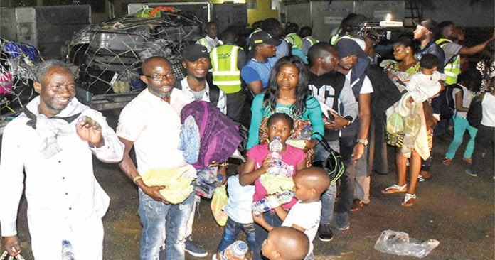 Image result for images of Sanwo-Olu Gives N20K Each To 315 Returnees From South Africa