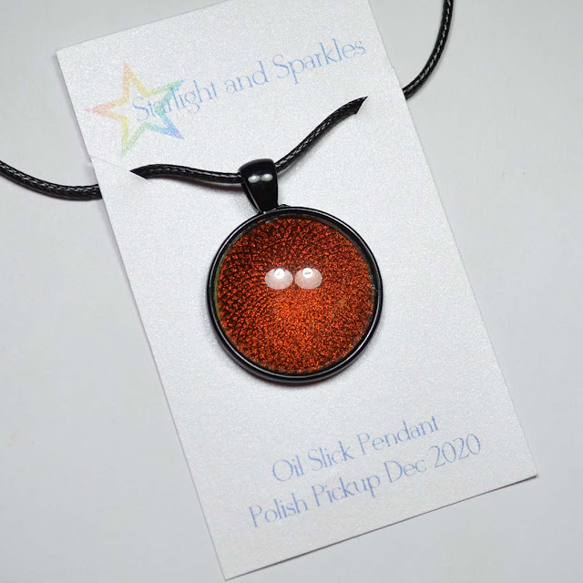 red shimmer nail polish pendant