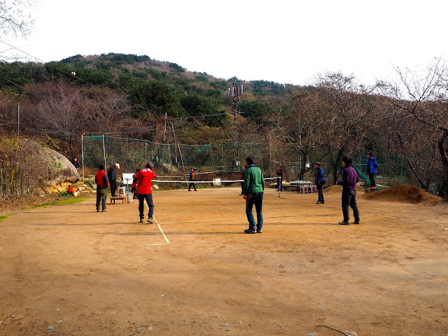 Locals playing games at the weekend in Namman Village on Geumjeongsan Mountain, Busan, South Korea