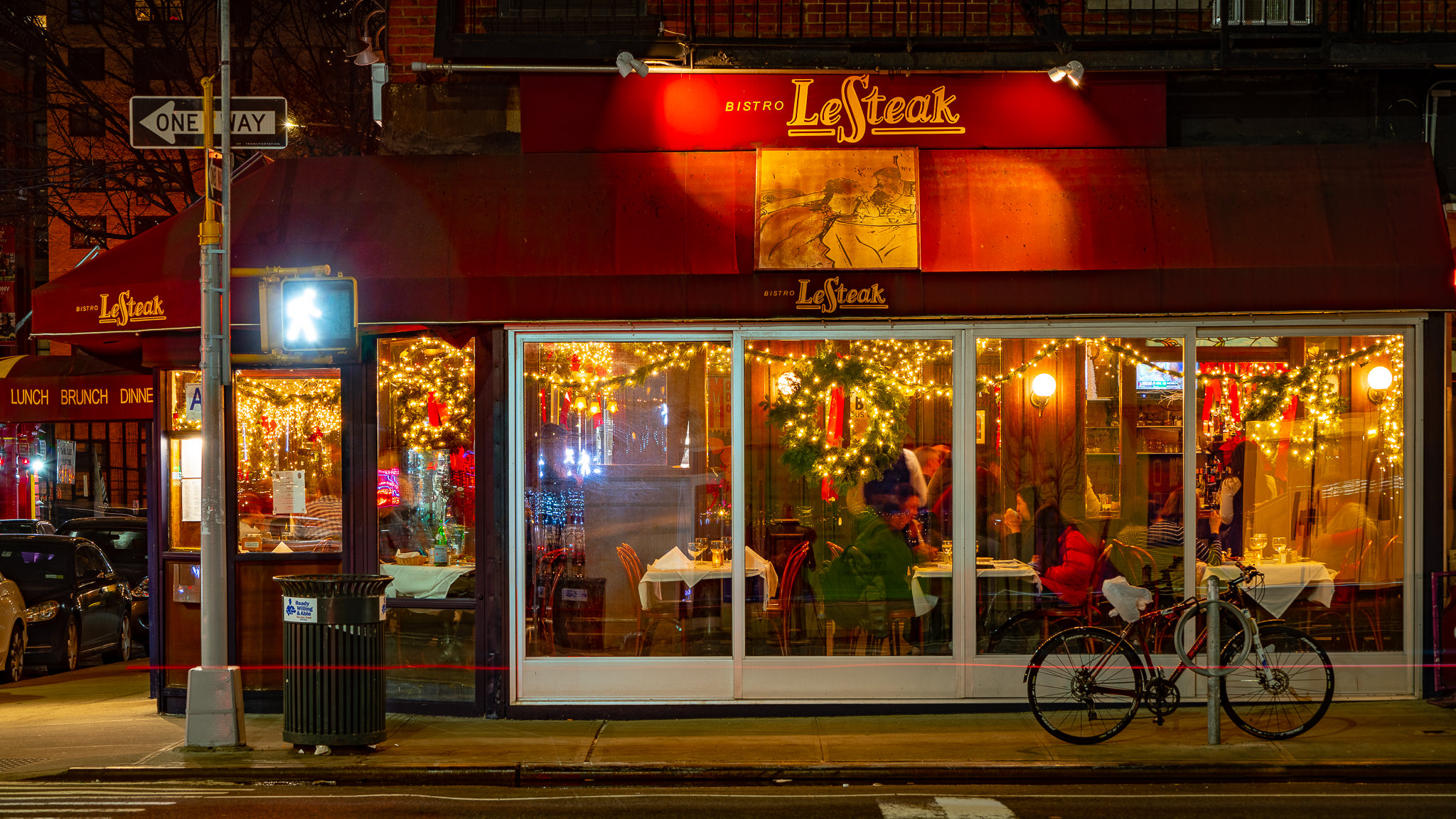 a photo of a new york bistro serving dinner to customers on christmas day