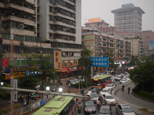 "View from the Qiaobei Road Overpass (桥北路立交) in Qingyuan including a sign for ""Th Donkey and Goat Food Street"""