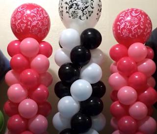 Mehrfarbige Mini-Ballonsäulen zur Tischdekoration.