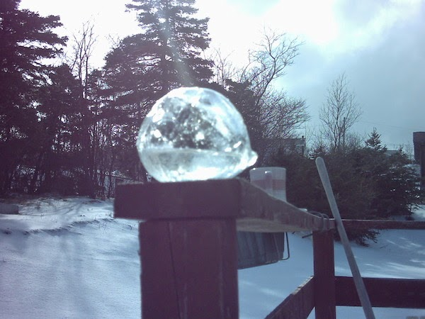 A frozen water balloon. - The 30 Most Amazing Photos Of Frozen Things In Honor Of The Coldest Morning Of The 21st Century