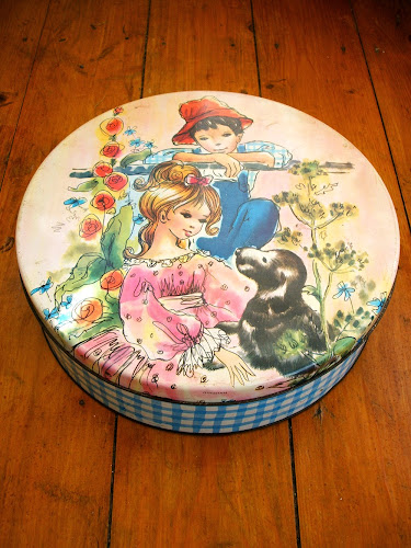 vintage gingham design kitsch enamel biscuit tin with girl, boy and dog