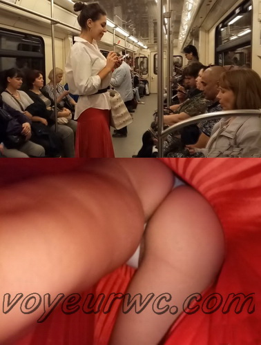 Upskirts 4034-4043 (Secretly taking an upskirt video of beautiful women on escalator)
