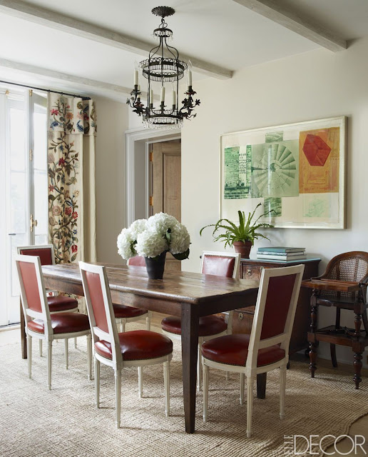 Emma Jane Pilkington home dining room with seagrass rug and red leather dining chairs