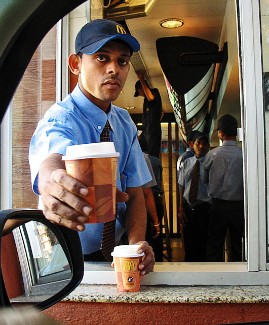 Serving coffee at drive-thru