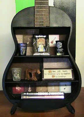 Idea para reciclar guitarras viejas.