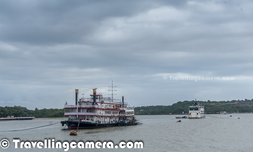 Taking a cruise on Mandovi river and experiencing the dynamic city Panajim by water is considered as one of the must do thing in Goa. Although options available during Monsoons are comparatively lesser. But still we thought of taking a cruise on Santa Monica, which is managed by Goa Tourism Department. This Photo Journey shares some moments from this cruise experience and more details on various options available in and around Goa.The Goa Tourism Development Corporation (GTDC) runs a variety of river cruises on the Mandovi river during daytime, sunset and moonlight. There are two types of day cruises which start from the Panaji jetty, down the Mandovi into the Zuari bay and up the Mandovi to Aldona and a mineral water spring. There are few private firms who also offer a variety of imaginative cruises or boat tours for sunset views as well as for crocodile or dolphin spotting. but we found is hard to identify these options during monsoons. Many of the folks gave us the reason that it's risky during monsoons to go deep into the sea, while we noticed many of the fishermen boats at a distance. Most probably, it's related to business reasons & low tourist inflow during monsoons.We opted for evening cruise from Goa Tourism office which is near to Mandovi river bridge which connects North Goa to it's southern part & Panjim. Santa Monica is considered as a pride of Goa Tourism Development. This is used for daily evening cruises on river Mandovi with 'live' cultural programs performed by the best cultural troupes of Goa. Usually one cruise duration is 1 to 1.5 hrs and it takes multiple rounds in evening. Ticket was 200 Rs per person which quite cheap. Santa Monica has huge capacity so Goa Tourist makes enough money. And don't miss the video of a gentleman dancing at the cruise :) . It's placed in the bottom of this postAt any point of time Santa Monica can accommodate approximately 200 guests. Inside the cruise, there is usually a bar counter which also serves very basic snacks, but not very exciting affair. very badly managed and crowd makes it worse. So we didn't even try to go near it. And fortunately it was just one hour. Santa Monica is also available for special parties on hourly basis and it seems, many folks book it for weddings as well. The Santa Monica cruise is the most attractive entertainment with live Goan Cultural Show and music on board. We loved this the most. There were some Goan performances by very sweet performers on the cruise. These performances keep you busy most of the time and you need to put efforts in taking out your attention & view other things around the river.As ride starts, it moves across the riverside with beautiful views of Panjim town. Then it moves towards the other and goes deep into the river. Various ships and steamers come on the way and many of the ships are used for local transportation. Many folks use these ships to cross river with their vehicles.There are different types of cruises available in Goa. Sunset Cruise one of the famous one which departs at 6.00 pm for one hour. The other one which starts at 7:15pm is known as Sundown Cruise. There is a special cruise called as Full Moon Cruise, which starts at 8:30pm & it's for 2 hours.  'Dolphin Fantasy Cruise' sounds very interesting :) . This cruise is only available on Mondays, during mornings. I guess, for 2 hours. Idea is to watch the dark graceful water beauties in a playful mood and the rhythmic dance of love - yes we are talking about Dolphins in Goa. This cruise helps in sighting closely the head lands jutting out into the sea, the Raj Bhavan, Aguada Fort & Reis Magos. There is another cruise offered by Goa Tourism - 'Pearl of the Orient'. I loved these names :) ... This is an interesting cruise with walking experience which helps in exploring natural & cultural heritage by visiting World Heritage Monuments at old Goa. We were not aware of this option when we visited Goa, otherwise this would have been our first option. This happens only during Saturdays and timings are from 9:30am to 1pm.If you want to experience Backwater Thrills cruise, plan your visit between Tuesday & Friday. Weekenders would miss this. This starts at 9:30am and ends at 4pm. It's about cruising along the riverine tip of Islands of Chorao, Divar, Old Goa. This cruise is very interesting for endless sights and sounds of Mandovi's thick mangroves. Cruise offers the experience of typical Goan cuisine served in earthen pots and banana leaf. It seems that Goa tourism also arranges special cruises for longer periods of time. Panaji jetty ticket counter is best place to find out more details about cruise options in Goa.Cruising around Goa is a fun activity and Goa Tourism department really does a very good job in managing these cruises very well with great flavor of goan culture and music. It's real fun to enjoy goan music on cruise with awesome performers. Most of the times, they also play music for guests, if they want to dance in the middle of the river :). If you plan for the cruise in Goa, be prepared for the long waiting queues and I am sure that wait would be more during the season. But it's all worthwhile.