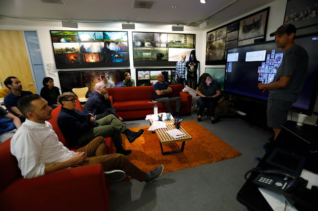 Art team gathers for an art review on Pixar's Onward
