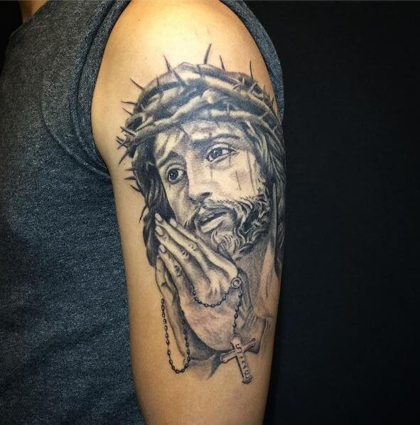 5a8cd5978 A Jesus tattoo with praying hands is also a good combo. It shows that every  second of your life is devoted to all-mighty god and you cherish every  moment of ...