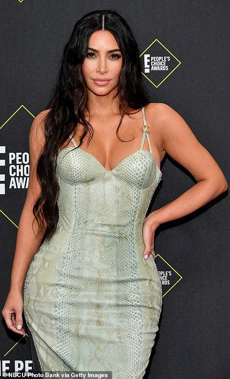 Kim Kardashian West shows off her hourglass figure in slinky snakeskin dress