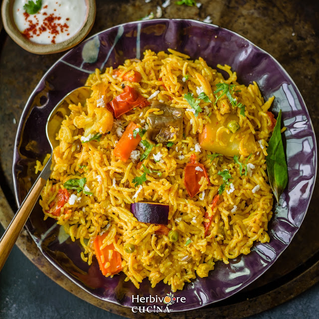 Plate of mixed vegetables, rice and spices.