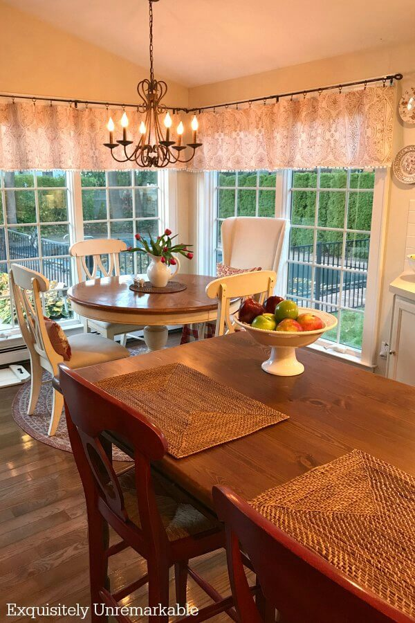 Charming Cottage Kitchen with white round table and wooden kitchen island