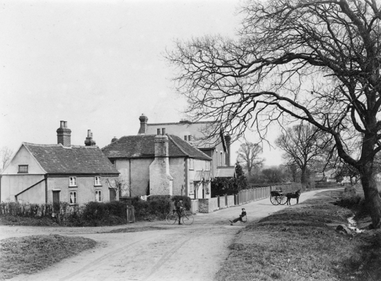 Photograph of Balloon Corner, Welham Green. Lunardi is said to have left his cat in the care of a woman living in one of the cottages, now demolished. Photograph by Geo. Knott. 1900.
