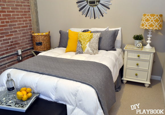 Yellow white and gray guest room