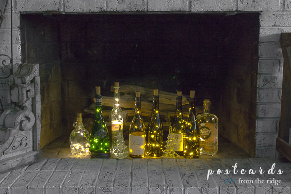 painted brick fireplace with wine bottle lights