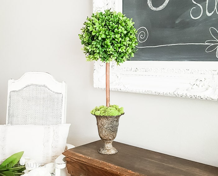 large boxwood topiary with faux greenery