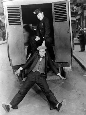 The Cameraman - Buster Keaton and Harry Gribbon (police van)