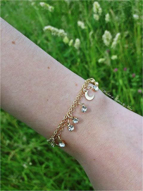 Złote bransoletki z kryształkami, księżycem i gwiazdkami Sinsay