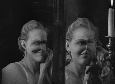 """A young Gloria Stuart stares into a mirror revealing her disfigured face in a movie scene for Universal's """"The Old Dark House"""""""