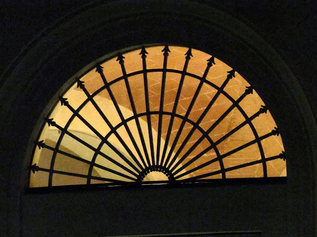 Fan window at night, via Bernardina, Livorno