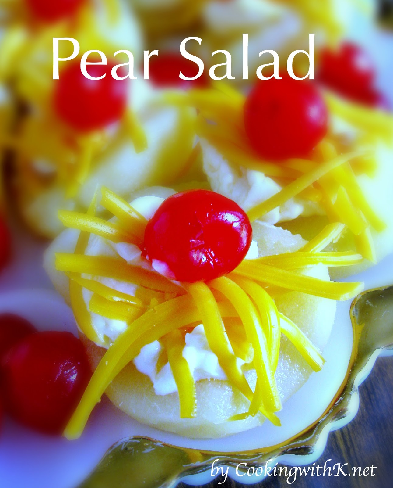 Pear Salad,  a vintage recipe going way back.  Pears are filled with mayonnaise and freshly grated cheddar cheese, then topped with a cherry.