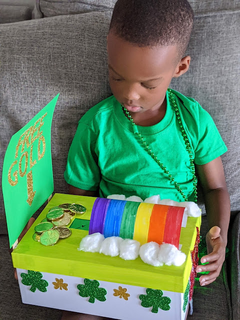 Young African American child holding a DIY leprechaun trap for St. Patrick's Day