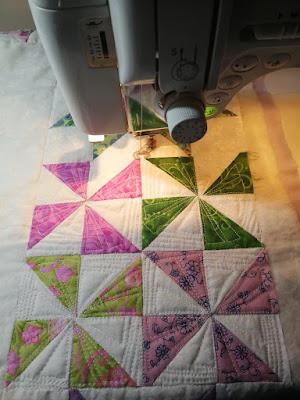Mini pinwheel shape in the background triangles