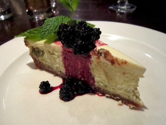Cheesecake with a blackberry sauce.