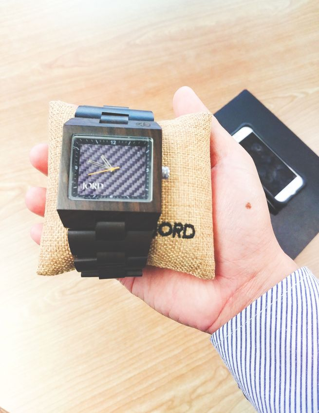 Holding a Jord engravable wood watch