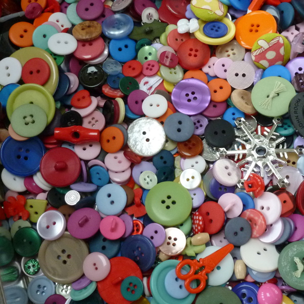Assortment of different buttons lots of colors and sizes and shapes