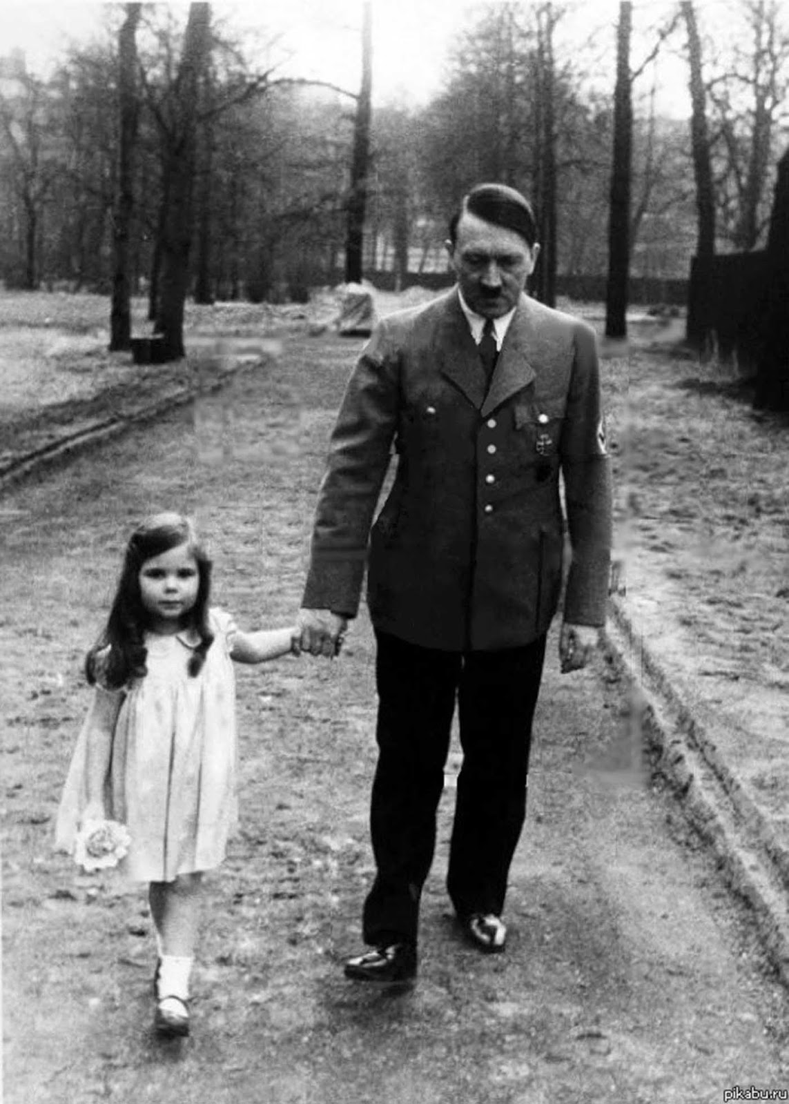 Adolf Hitler on a walk with Helga Goebbels.