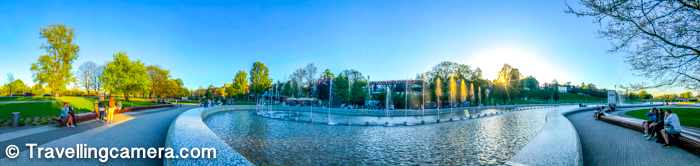 Here is a panoramic view of Multimedia Water Fountain Park in Warsaw Old Town. In this photograph you notice that not lot many people are sitting around the fountains but usually both sides of the both walking tracks around the fountains.
