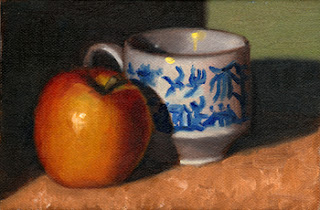 Oil painting of a Pink Lady apple beside a willow pattern teacup.