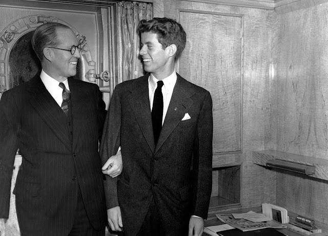 In this January 5, 1938 file photo, Joseph P. Kennedy, left, U.S. Ambassador to Great Britain, stands with his 20 year old son, John F. Kennedy, in New York. Kennedy was the second son, and one of nine children, of business tycoon Joseph P. Kennedy. When first son Joseph Jr. was killed during World War II, John became the designated heir.