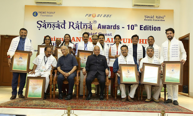 Sansad Ratna 2019 Awardees Sitting: L to R – Dr Veerappa Moily, T S Krishnamurthy, Hon'ble Governor of Tamil Nadu Sri Banwarilal Purohit, Bartruhari Mahtab, Ananda Bhaskar Rapolu Standing: L to R – Nishikant Dubey, Rajani Patil, Dr Heena Gavit, N K Premachandran, Rajeev Shankarrao Satav,    Supriya Sule, Dhananjay Bhimrao Mahadik, Shrirang Appa Barne, Anurag Thakur