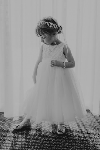 Photo shoot of flower girl before ceremony.