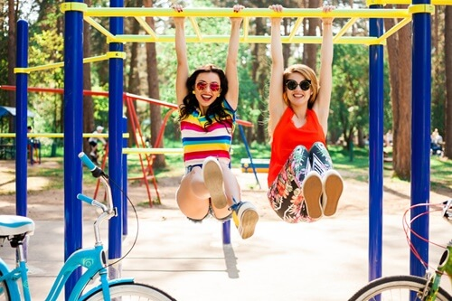 Happy with friends while enjoying the slide
